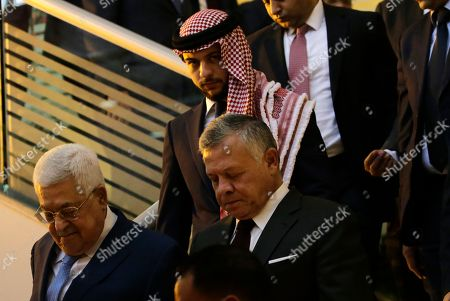 King Abdullah II of Jordan (R), Palestinian President Mahmoud Abbas (L) and Crown Prince of Jordan Al Hussein bin Abdullah (2-L) arrive to attend the Churches Christmas and New Year celebration event at King Hussein Cultural Center, in Amman, Jordan, 18 December 2018. Jordan's King Abdullah II and his guest Palestinian President Mahmoud Abbas attended the celebration along with leaders of Catholic, Orthodox, and Coptic churches in Jordan and Palestine as well as Muslim dignitaries.