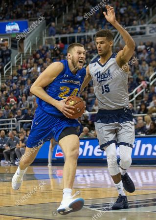Mike Daum, Trey Porter. South Dakota State forward Mike Daum (24) drives in the lane against Nevada's Trey Porter (15) in the second half of an NCAA college basketball game in Reno, Nev
