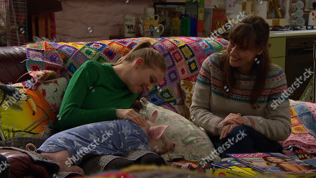 Ep 8367 Tuesday 15th January 2019 Sam Dingle, is pleased with himself as he presents incredulous Belle Dingle, as played by Eden Taylor-Draper, and Lydia, as played by Karen Blick, with their surprise. A lovely piglet called Spamela Hamderson.