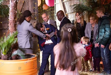 Ep 8347 Tuesday 25th December 2018  Soon the guests start to arrive, oblivious to the fact they're actually attending a wedding and soon they are shocked to see Jessie Grant, in a wedding dress. Will the wedding go smoothly especially after Marlon Dinlge, as played by Mark Charnock, faints when it's revealed it is in fact his own wedding day. Whilst poor Sam Dingle, as played by James Hooton, is crushed to learn he's got it all wrong. With Noah Dingle, as played by Jack Downham ; Charity Dingle, as played by Emma Atkins ; Vanessa Woodfield, as played by Michelle Hardwick.