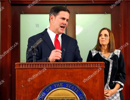 Arizona Gov. Doug Ducey announces during a news conference, at the Capitol in Phoenix, his appointment of U.S. Rep. Martha McSally, R-Ariz., left, to replace U.S. Sen. Jon Kyl, R-Ariz., in the U.S. Senate seat that belonged to Sen. John McCain. McSally will take over after Kyl's resignation becomes effective Dec. 31