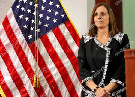 U.S. Rep. Martha McSally, R-Ariz., waits to speak during a news conference, at the Capitol in Phoenix, where Arizona Gov. Doug Ducey, rear, announced his decision to replace U.S. Sen. Jon Kyl, R-Ariz. with McSally in the U.S. Senate seat that belonged to Sen. John McCain. McSally will take over after Kyl's resignation becomes effective Dec. 31