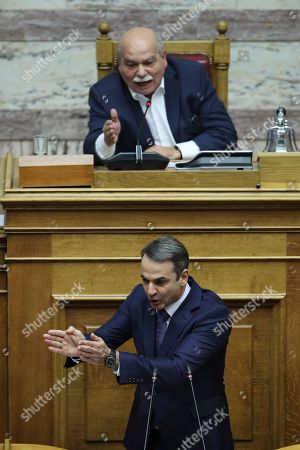 Kyriakos Mitsotakis, Nikos Voutsis. New Democracy party leader Kyriakos Mitsotakis, front, argues with Greek Parliament Speaker Nikos Voutsis during a parliament session in Athens on. Greek lawmakers are debating the heavily-indebted country's draft budget for 2019, the first since Greece exited an eight-year bailout program