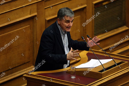 Greek Finance Minister Euclid Tsakalotos delivers a speech during a session in the parliament's plenum prior to a budget vote in Athens, Greece, 18 December 2018. The debate on the Greek government's 2019 draft budget started at the parliament five days ago and is scheduled to be concluded after voting tonight.