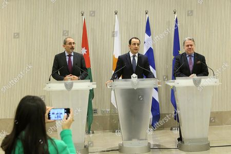 Stock Image of Nicos Christodoulides, Ayman Safadi, Georgios Katrougalos. Cypriot foreign minister Nicos Christodoulides, center, Foreign minister of Jordan Ayman Safadi, left, and the Greek Alternate Minister of Foreign Affairs Georgios Katrougalos talk to the media during a press conference after their meeting at the presidential palace in Nicosia, Cyprus, . The three ministers are meeting in the Cypriot capital to explore ways of strengthening ties on fields as varied as education and entrepreneurship