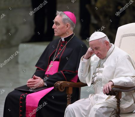Pope Francis flanked by Monsignor Georg Ganswein