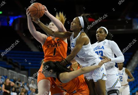 Oklahoma State center Kassidy De Lapp (1) reaches for the ball while Maria Castro (30) tries to block out UCLA Bruins forward Lajahna Drummer (11) and guard Natalie Chou (23) in the first half during an NCAA college womens basketball game, in Los Angeles. UCLA won 71-59