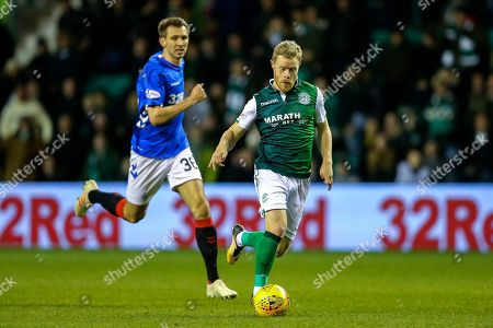 Daryl Horgan (#7) of Hibernian on the ball pursued by Gareth McAuley (#36) of Rangers during the Ladbrokes Scottish Premiership match between Hibernian and Rangers at Easter Road, Edinburgh