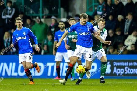 Gareth McAuley (#36) of Rangers defends the ball against the challenge of Florian Kamberi (#22) of Hibernian during the Ladbrokes Scottish Premiership match between Hibernian and Rangers at Easter Road, Edinburgh