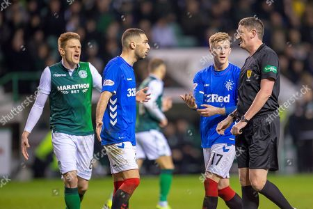 Eros Grezda (#35) and Ross McCrorie (#17) of Rangers FC appeal to referee Craig Thomson for handball during the Ladbrokes Scottish Premiership match between Hibernian and Rangers at Easter Road, Edinburgh