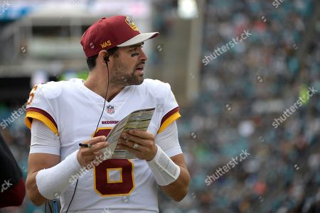Washington Redskins quarterback Mark Sanchez (6) watches from the sideline during the first half of an NFL football game against the Jacksonville Jaguars, in Jacksonville, Fla