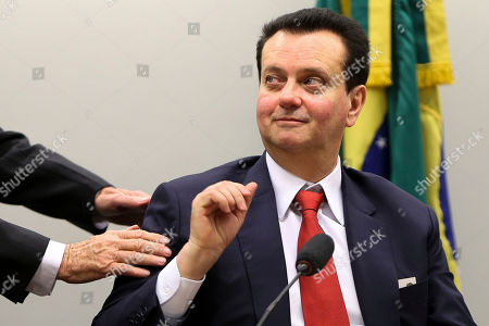 In this Sept. 5, 2018 handout photo released by Agencia Brasil, Science and Technology Minister Gilberto Kassab attends a session in Congress, in Brasilia, Brazil. Brazilian Federal Police raided Kassab's home, following accusations that he received millions in bribes from the JBS food company between 2010 and 2016