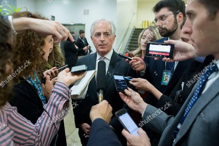 Senate Foreign Relations Committee Chairman Republican Bob Corker (C) speaks to members of the news media near the Senate subway on Capitol Hill in Washington, DC, USA, 19 December 2018. Senate Democratic leadership and Republican leadership have come to an agreement to fund the federal government through 08 February 2019. The agreement must be voted on in the Senate and then go to the House of Representatives for approval in order to avert a partial shutdown when funding expires at the end of 21 December 2018.