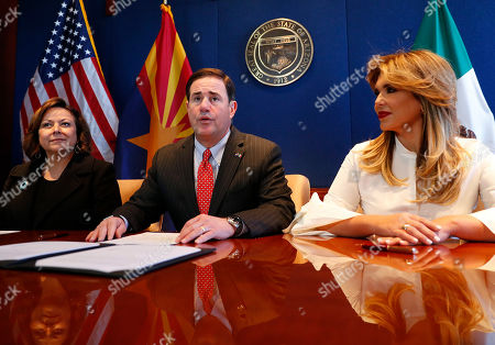 Arizona Gov. Doug Ducey, center, New Mexico Gov. Susana Martinez, left, and Gov. Claudia Pavlovich of Mexico's Sonora state prepare to sign an agreement to a cross-border plan to provide natural gas to Asia., at the Capitol in Phoenix