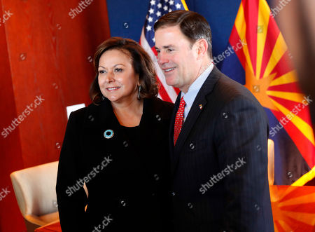 Republican governors Doug Ducey, Arizona, and Susana Martinez, New Mexico pose for a photographer prior to signing an agreement to a cross-border plan to provide natural gas to Asia., at the Capitol in Phoenix