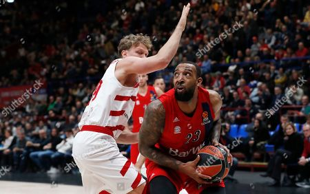 Bayern Munich's Derrick Williams, right, challenges for the ball with Olimpia Milan's Mindaugas Kuzminskas during the Euro League basketball match between Olimpia Milan and Bayern Munich, in Milan, Italy