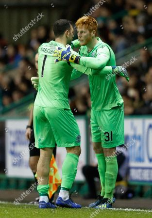 Hibernian goalkeeper Ofir Marciano is replaced by Adam Bogdan after he picked up an injury early in the match.