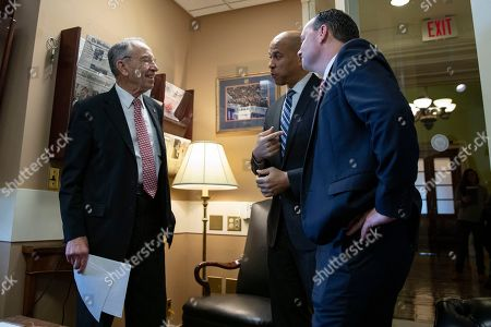 Senator Chuck Grassley, Chairman of the Senate Judiciary Committee, Republican of Iowa, left, Senator Cory Booker, Democrat of New Jersey, center, and Senator Mike Lee, Republican of Utah, converse prior to a news conference celebrating the passage of the First Step Act at the United States Capitol in Washington, DC.