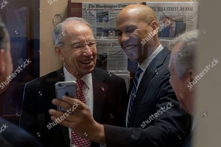 Senator Chuck Grassley, Chairman of the Senate Judiciary Committee, Republican of Iowa, left, Senator Cory Booker, Democrat of New Jersey, right, take a Facebook Live video prior to a news conference celebrating the passage of the First Step Act at the United States Capitol in Washington, DC.