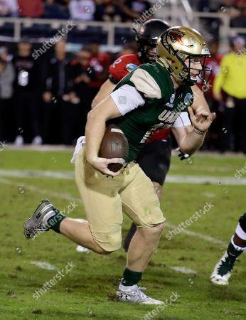UAB quarterback Tyler Johnston III runs during the second half of the Boca Raton Bowl NCAA college football game against Northern Illinois, in Boca Raton, Fla. UAB won 37-13