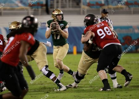 UAB quarterback Tyler Johnston III (17) looks to pass during the first half of the Boca Raton Bowl NCAA college football game against Northern Illinois, in Boca Raton, Fla