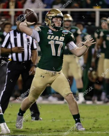 UAB quarterback Tyler Johnston III (17) passes during the first half of the Boca Raton Bowl NCAA college football game against Northern Illinois, in Boca Raton, Fla