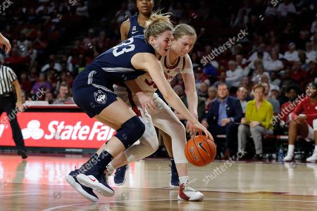 Connecticut guard/forward Katie Lou Samuelson (33) and Oklahoma guard Taylor Robertson (30) compete for a loose ball during the first half of an NCAA college basketball game in Norman, Okla