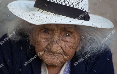 Julia Flores Colque, born on Oct. 26, 1900 in a mining camp in the Bolivian mountains, looks into the camera outside her home in Sacaba, Bolivia. At age 117, Colque is be the oldest woman in the Andean nation and perhaps the oldest living person in the world