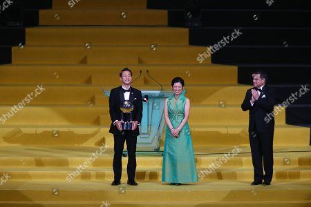 Kota Mizunuma of Cerezo Osaka receives the Fair-Play Award (Prince Takamado Cup) trophy from JFA honorary president Hisako, Princess Takamado as JFA president Kozo Tashima applauds