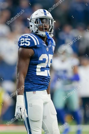 Stock Picture of Indianapolis Colts running back Marlon Mack looks up at the scoreboard after scoring a touchdown during the first half of an NFL football game against the Dallas Cowboys, in Indianapolis. Mack joined Eric Dickerson and Edgerrin James as the only players in franchise history with multiple games of at least 125 yards rushing yards and two TDs rushing in a season