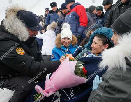 Dmitry Rogozin (L), head of the Russian space agency Roscosmos, presents flowers to astronaut Serena Aunon-Chancellor (R) of the US shortly after Soyuz MS-09 capsule landing in a remote area outside the town of Zhezkazgan (Dzhezkazgan or Jezkazgan), Kazakhstan, 20 December 2018. The Soyuz MS-09 capsule with astronauts Alexander Gerst of Germany and Serena Aunon-Chancellor of the USA, and cosmonaut Sergey Prokopyev of Russia safely returned to Earth in the Kazakh steppe on 20 December 2018 after 197 days in space where they served as members of the Expedition 56 and 57 crews onboard the International Space Station (ISS).