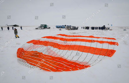 A search and rescue team approaches the Soyuz MS-09 capsule carrying the International Space Station (ISS) crew of astronauts Serena Aunon-Chancellor of the US, Alexander Gerst of Germany and cosmonaut Sergey Prokopyev of Russia after its landing in a remote area outside the town of Zhezkazgan (Dzhezkazgan or Jezkazgan), Kazakhstan, 20 December 2018. The Soyuz MS-09 capsule with astronauts Alexander Gerst of Germany and Serena Aunon-Chancellor of the USA, and cosmonaut Sergey Prokopyev of Russia safely returned to Earth in the Kazakh steppe on 20 December 2018 after 197 days in space where they served as members of the Expedition 56 and 57 crews onboard the International Space Station (ISS).