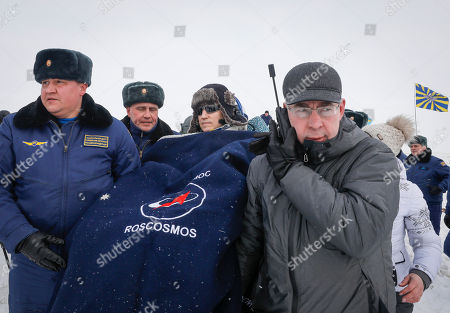 Ground personnel carry International Space Station (ISS) crew member cosmonaut Sergey Prokopyev (C) of Russia shortly after Soyuz MS-09 capsule landing in a remote area outside the town of Zhezkazgan (Dzhezkazgan or Jezkazgan), Kazakhstan, 20 December 2018. The Soyuz MS-09 capsule with astronauts Alexander Gerst of Germany and Serena Aunon-Chancellor of the USA, and cosmonaut Sergey Prokopyev of Russia safely returned to Earth in the Kazakh steppe on 20 December 2018 after 197 days in space where they served as members of the Expedition 56 and 57 crews onboard the International Space Station (ISS).