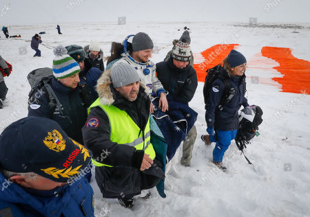 Ground personnel carry International Space Station (ISS) crew member astronaut Alexander Gerst (C) of Germany shortly after Soyuz MS-09 capsule landing in a remote area outside the town of Zhezkazgan (Dzhezkazgan or Jezkazgan), Kazakhstan, 20 December 2018. The Soyuz MS-09 capsule with astronauts Alexander Gerst of Germany and Serena Aunon-Chancellor of the USA, and cosmonaut Sergey Prokopyev of Russia safely returned to Earth in the Kazakh steppe on 20 December 2018 after 197 days in space where they served as members of the Expedition 56 and 57 crews onboard the International Space Station (ISS).