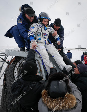 Ground personnel help International Space Station (ISS) crew member astronaut Serena Aunon-Chancellor (C) of the US to get out of Soyuz MS-09 capsule shortly after its landing in a remote area outside the town of Zhezkazgan (Dzhezkazgan or Jezkazgan), Kazakhstan, 20 December 2018. The Soyuz MS-09 capsule with astronauts Alexander Gerst of Germany and Serena Aunon-Chancellor of the USA, and cosmonaut Sergey Prokopyev of Russia safely returned to Earth in the Kazakh steppe on 20 December 2018 after 197 days in space where they served as members of the Expedition 56 and 57 crews onboard the International Space Station (ISS).