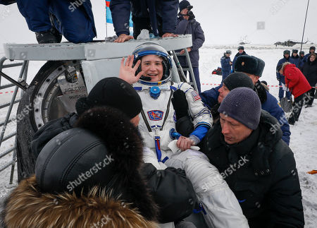 Ground personnel carry International Space Station (ISS) crew member astronauts Serena Aunon-Chancellor (C) of the US shortly after Soyuz MS-09 capsule landing in a remote area outside the town of Zhezkazgan (Dzhezkazgan or Jezkazgan), Kazakhstan, 20 December 2018. The Soyuz MS-09 capsule with astronauts Alexander Gerst of Germany and Serena Aunon-Chancellor of the USA, and cosmonaut Sergey Prokopyev of Russia safely returned to Earth in the Kazakh steppe on 20 December 2018 after 197 days in space where they served as members of the Expedition 56 and 57 crews onboard the International Space Station (ISS).