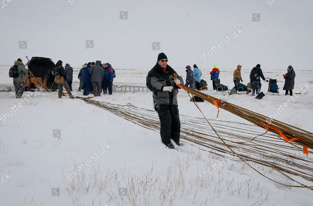 Search and rescue team works on the site of landing of the Soyuz MS-09 capsule carrying the International Space Station (ISS) crew of astronauts Serena Aunon-Chancellor of the US and Alexander Gerst of Germany and cosmonaut Sergey Prokopyev of Russia in a remote area outside the town of Zhezkazgan (Dzhezkazgan or Jezkazgan), Kazakhstan, 20 December 2018. The Soyuz MS-09 capsule with astronauts Alexander Gerst of Germany and Serena Aunon-Chancellor of the USA, and cosmonaut Sergey Prokopyev of Russia safely returned to Earth in the Kazakh steppe on 20 December 2018 after 197 days in space where they served as members of the Expedition 56 and 57 crews onboard the International Space Station (ISS).