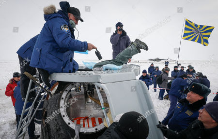 A search and rescue team works on the site of landing of the Soyuz MS-09 capsule carrying the International Space Station (ISS) crew of astronauts Serena Aunon-Chancellor of the US and Alexander Gerst of Germany and cosmonaut Sergey Prokopyev of Russia in a remote area outside the town of Zhezkazgan (Dzhezkazgan or Jezkazgan), Kazakhstan, 20 December 2018. The Soyuz MS-09 capsule with astronauts Alexander Gerst of Germany and Serena Aunon-Chancellor of the USA, and cosmonaut Sergey Prokopyev of Russia safely returned to Earth in the Kazakh steppe on 20 December 2018 after 197 days in space where they served as members of the Expedition 56 and 57 crews onboard the International Space Station (ISS).