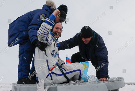 Ground personnel help International Space Station (ISS) crew member astronaut Alexander Gerst of Germany to get out of the Soyuz MS-09 capsule shortly after its landing in a remote area outside the town of Zhezkazgan (Dzhezkazgan or Jezkazgan), Kazakhstan, 20 December 2018. The Soyuz MS-09 capsule with astronauts Alexander Gerst of Germany and Serena Aunon-Chancellor of the USA, and cosmonaut Sergey Prokopyev of Russia safely returned to Earth in the Kazakh steppe on 20 December 2018 after 197 days in space where they served as members of the Expedition 56 and 57 crews onboard the International Space Station (ISS).