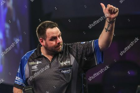 Adrian Lewis waves to the crowd at the end of the match during the World Darts Championships 2018 at Alexandra Palace, London