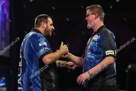 Adrian Lewis beats Ted Evetts in his second round match and celebrates during the World Darts Championships 2018 at Alexandra Palace, London