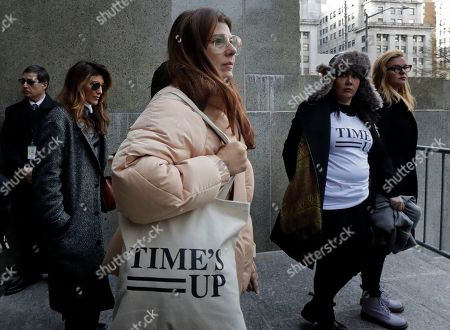 Marisa Tomei, center, leaves New York Supreme Court after attending a hearing in the Harvey Weinstein sexual assault case, in New York. With Jennifer Esposito and Amber Tamblyn