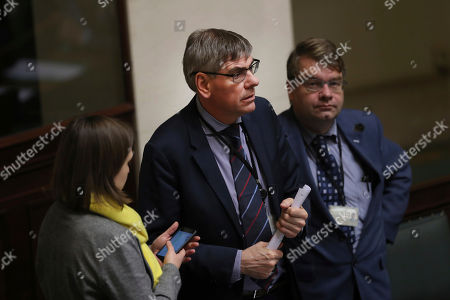 Leading member of Belgium's right-wing party Vlaams Belang, Filip Dewinter, center, attends a session of Belgian Federal Parliament in Brussels