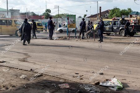 Police officers gather to clear the scene where opposition supporters set tires alight to protest after the electoral commission announced that the poll will be delayed by one week, in Kinshasa, Democratic Republic of the Congo, 20 December 2018. The head of Congo's electoral commission Corneille Nangaa announced on 20 December that the poll, orignially scheduled for 23 December will be delayed by one week until 30 December, citing the recent fire that destroyed 80 percent of the voting machines. Emmanuel Ramazani Shadary, the ruling party candidate and a loyalist of outgoing president Joseph Kabila, faces challenges posed by Felix Tshisekedi, the leader of the Union for Democracy and Social Progress (UDPS) party, and the joint opposition candidate Martin Fayulu.