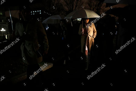 White House press secretary Sarah Huckabee Sanders, right, walks away from the cameras after answering questions about the departure of Defense Secretary Jim Mattis, at the White House in Washington