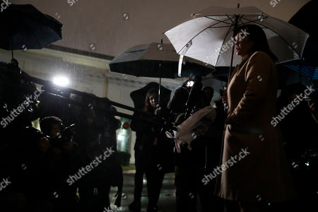 White House press secretary Sarah Huckabee Sanders answers questions in the rain about the departure of Defense Secretary Jim Mattis, at the White House in Washington