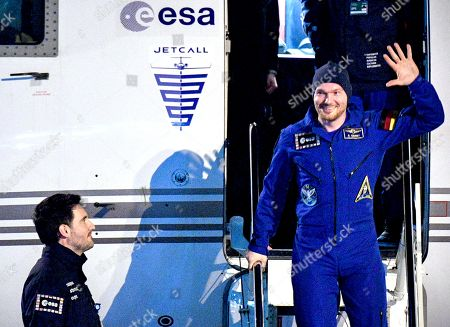 European Space Agency (ESA) astronaut Alexander Gerst (R) of Germany smiles and waves to the media as he arrives at the military part of the Cologne-Bonn airport, Germany, 20 December 2018. After 197 days in space, Alexander Gerst, who served as commander of the International Space Station ISS until his return, landed safely in a Soyuz MS-09 capsule near Karaganda in the steppe of Kazakhstan earlier this 20 December morning. A special aircraft brought him back to Germany with a stopover in Norway. After his return to earth, the 42-year-old will spend the next few days at the space medical research centre 'envihab' in Cologne, where he will be jointly supervised by the German Aerospace Center (Deutsches Zentrum fuer Luft- und Raumfahrt e.V., or DLR) and the European Astronaut Centre (EAC).
