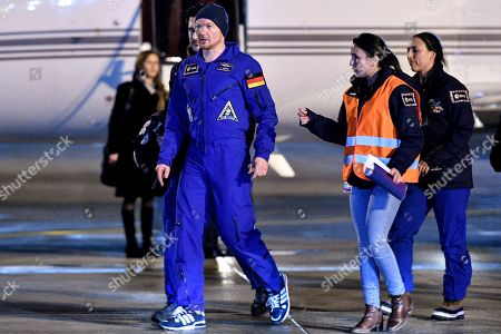 European Space Agency (ESA) astronaut Alexander Gerst (C) of Germany arrives on the military part of the Cologne-Bonn airport, Germany, 20 December 2018. After 197 days in space, Alexander Gerst, who served as commander of the International Space Station ISS until his return, landed safely in a Soyuz MS-09 capsule near Karaganda in the steppe of Kazakhstan earlier this 20 December morning. A special aircraft brought him back to Germany with a stopover in Norway. After his return to earth, the 42-year-old will spend the next few days at the space medical research centre 'envihab' in Cologne, where he will be jointly supervised by the German Aerospace Center (Deutsches Zentrum fuer Luft- und Raumfahrt e.V., or DLR) and the European Astronaut Centre (EAC).