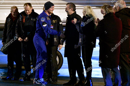 European Space Agency (ESA) astronaut Alexander Gerst (3-L) of Germany is welcomed upon his arrival on the military part of the Cologne-Bonn airport, Germany, 20 December 2018. After 197 days in space, Alexander Gerst, who served as commander of the International Space Station ISS until his return, landed safely in a Soyuz MS-09 capsule near Karaganda in the steppe of Kazakhstan earlier this 20 December morning. A special aircraft brought him back to Germany with a stopover in Norway. After his return to earth, the 42-year-old will spend the next few days at the space medical research centre 'envihab' in Cologne, where he will be jointly supervised by the German Aerospace Center (Deutsches Zentrum fuer Luft- und Raumfahrt e.V., or DLR) and the European Astronaut Centre (EAC).