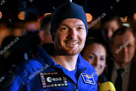 European Space Agency (ESA) astronaut Alexander Gerst of Germany smiles as he arrives at the military part of the Cologne-Bonn airport, Germany, 20 December 2018. After 197 days in space, Alexander Gerst, who served as commander of the International Space Station ISS until his return, landed safely in a Soyuz MS-09 capsule near Karaganda in the steppe of Kazakhstan earlier this 20 December morning. A special aircraft brought him back to Germany with a stopover in Norway. After his return to earth, the 42-year-old will spend the next few days at the space medical research centre 'envihab' in Cologne, where he will be jointly supervised by the German Aerospace Center (Deutsches Zentrum fuer Luft- und Raumfahrt e.V., or DLR) and the European Astronaut Centre (EAC).